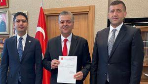 MHP Genel Başkan Yardımcısı Yalçın İncetoprak'a görevi tebliğ etti